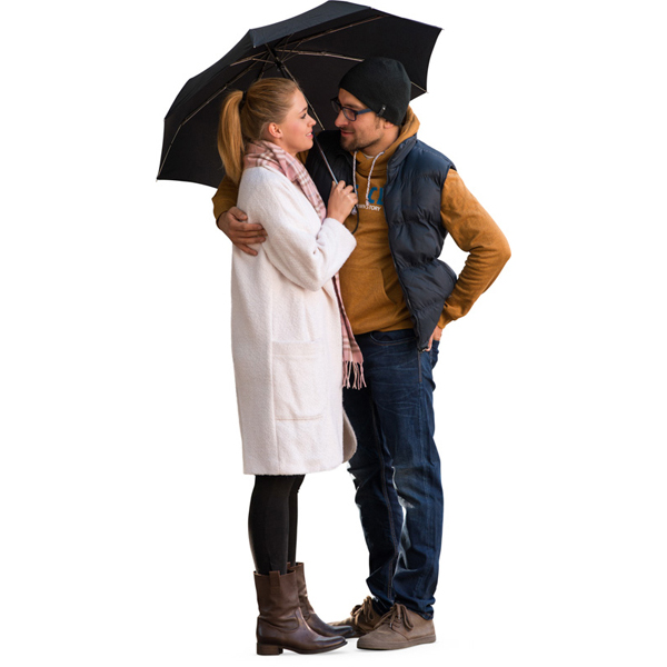 Couple hugging under umbrella cut out