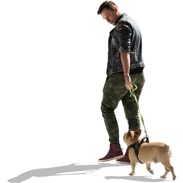 White male walking with dog in sunlight cut out